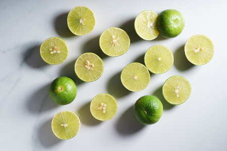 fresh limes with slice and leaves Stock Photo