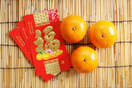 pow: Chinese new year festival decorations, ang pow or red packets and mandarin oranges Stock Photo
