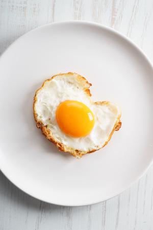 protien: Crispy Fried Egg on white plate Stock Photo