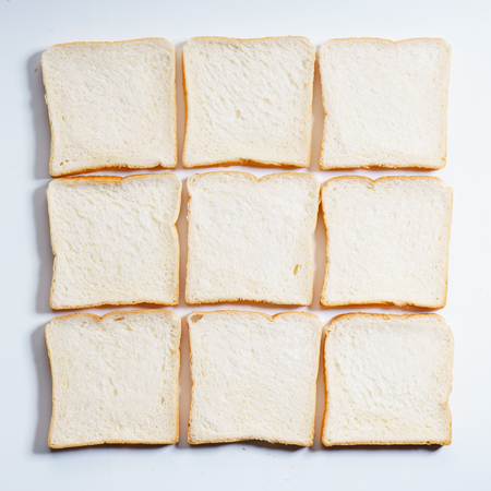 sliced white bread arrange as square table, top view