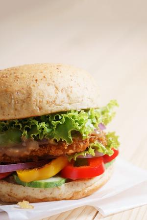 vegetarian hamburger: crispy pork burger with fresh vegetable and grilled pepper Stock Photo