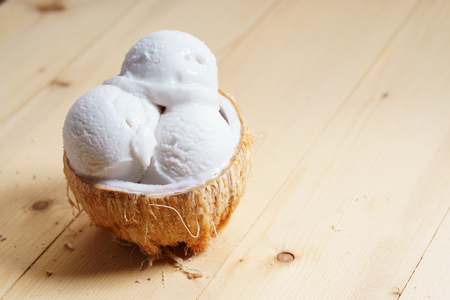 coconut ice cream scoops on coconut cup