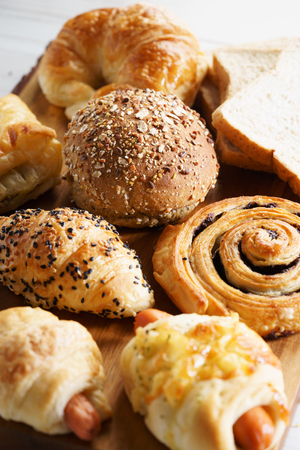 mixed breads and rolls on wooden background Stock Photo