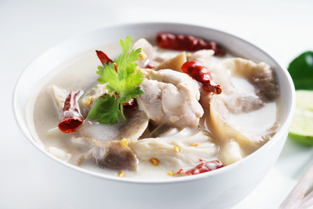chicken coconut soup with mushroom and herbs in sour taste