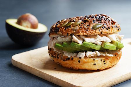 healthy burger with sliced avocado, chicken and wholegrain bread 스톡 콘텐츠