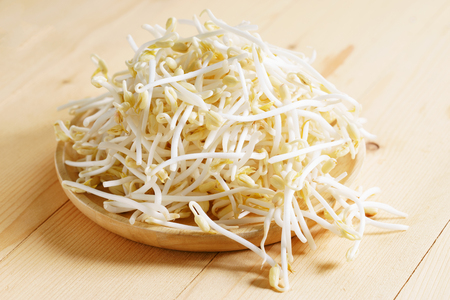 Raw white bean sprouts in wooden plate Stock Photo