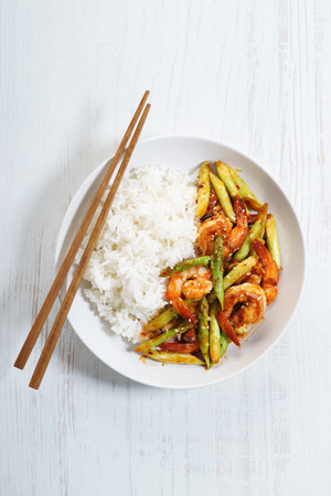 Prawn meat with spicy sauce and asparagus served with rice