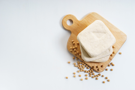 soy beans and tofu on wooden plank Stock fotó - 104387103