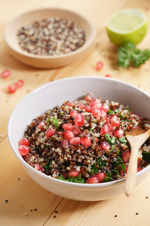 quinoa salad with pomegranate and lime, healthy food.
