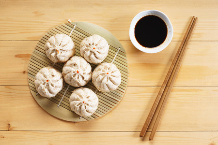 Chinese steamed bun on wooden basketwork