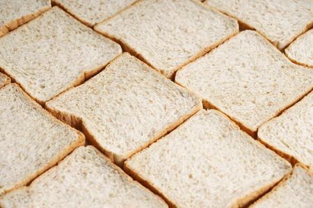 whole wheat bread slices Фото со стока
