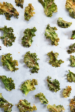 Homemade green kale chips with white sesame 写真素材