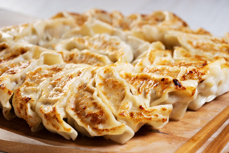 Japanese dumplings, gyoza with pork meat and vegetable stuff, closeup Stock Photo - 119045770