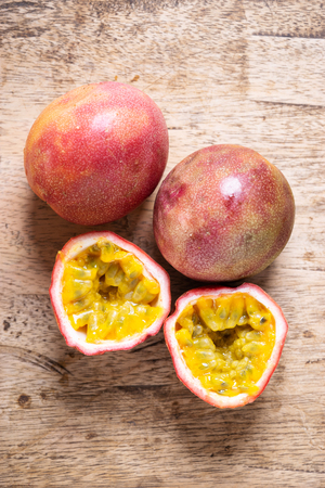 Ripe passion fruit on wooden background, top view Stok Fotoğraf
