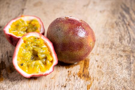 Ripe passion fruit on wooden background, closeup Stok Fotoğraf