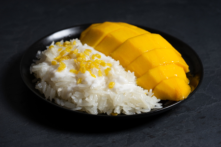 mango and sticky rice with coconut milk, traditional Thai dessert