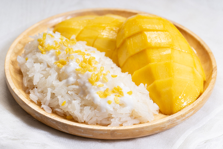 fresh ripe mango and sticky rice with coconut milk, authentic Thai dessert