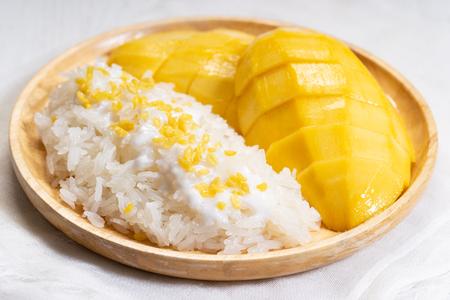 fresh ripe mango and sticky rice with coconut milk, authentic Thai dessert