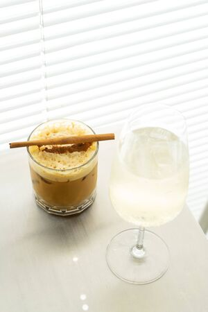 iced milk coffee with bubble and cinnamon stick on table Reklamní fotografie