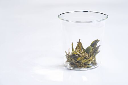Soaked tea leaves in a glass