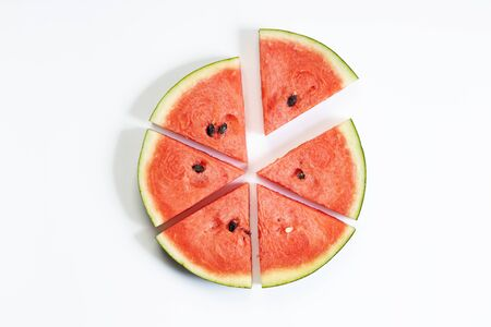 Fresh watermelon slices in a triangle on white background, top view