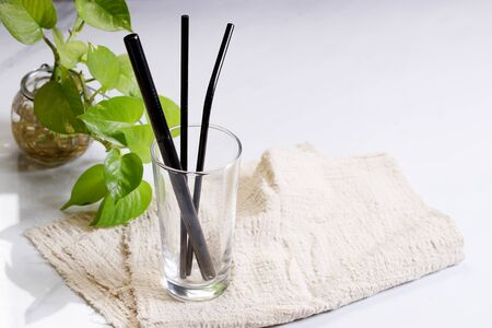 Reusable stainless steel straws in a glass, eco friendly lifestyle