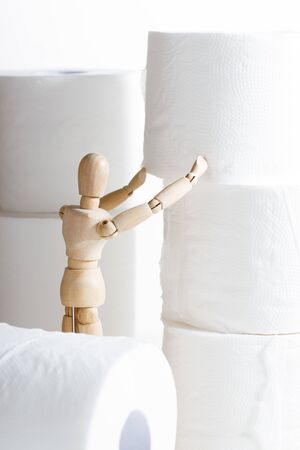 paper tissue rolls with wooden model on white background, stock up goods concept
