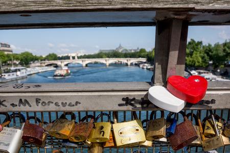 declaring: Love locks on Pont de Arts bridge in Paris with view to River Seine and bridges Stock Photo