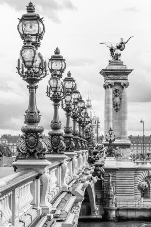iii: Pont Alexandre III bridge Paris in black and white with row of street lamps