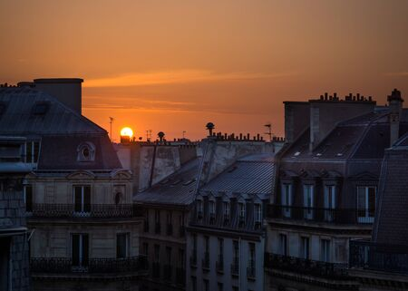 city of sunrise: Sunrise over the roof tops and chimneys in Paris city