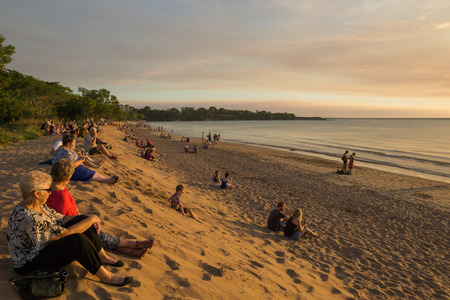 Darwin, Australia May 15 2014: Many people sit and watch as the sun goes down at Mindil Beach