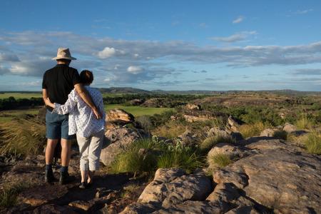 kakadu: Man and woman enjoying view with arm round each other at Ubirr, Kakadu