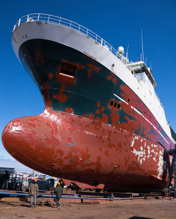 drydock: Large ship in dry dock preparing for painting and repairs Stock Photo