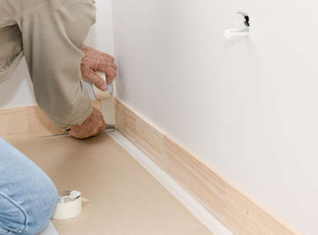 masking: Builder masking and preparing for painting Stock Photo