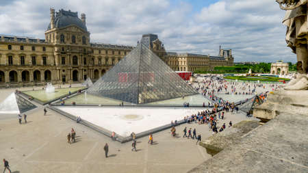 louvre pyramid: Paris, France May 28 2015: The Louvre Pyramid and buildings with many people walking around, taken from high view point
