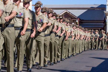 Charters Towers, Australia April 25, 2015: Anzac Day Parade with soldiers marching down main street of town.