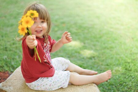 posy: Little girl giving posy of yellow daisies