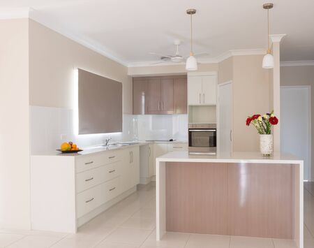 kitchen island: Light, bright new kitchen with island bench in new house Stock Photo