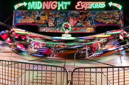 carnival ride: Charters Towers, Australia: August 2, 2016 - A colourful carnival ride, Midnight Express, going at high speed at the local show. Editorial