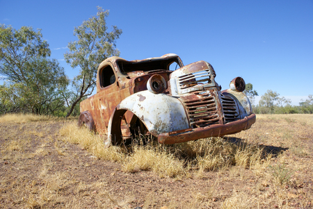 Old rusty car in outback paddock, Australia