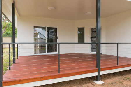 New timber deck on contemporary style home Archivio Fotografico