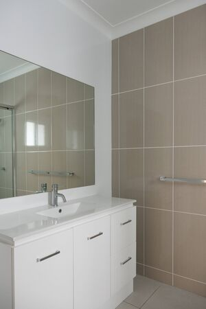 bathroom wall: Contemporary style bathroom with vanity tiled wall
