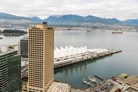 Vancouver, Canada - January 28, 2017: Vancouver city with Canada Place and mountains in the background