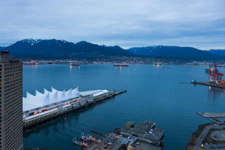 Vancouver, Canada - January 28, 2017: Canada Place and Vancouver harbour from above at night.