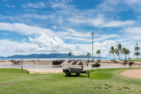 Workers on The Strand, Townsville, cleaning the public Rock Pool after emptying all the water Stock Photo