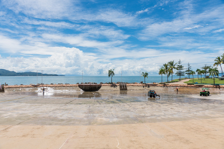 Workers on The Strand, Townsville, Australia, cleaning the public Rock Pool after emptying all the water ready for refilling