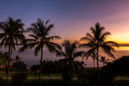 Sunrise on tropical beach, The Strand, Townsville, Australia Stock Photo