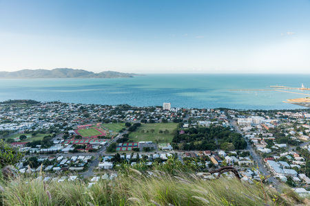 Townsville and Magnetic Island in the distance from high viewpoint of Castle Hill, North Queensland, Australia