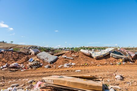 Household goods on rubbish heap at refuse collection site