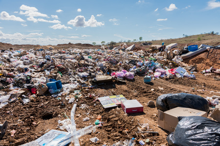 Piles of household refuse in dumping area at local tip